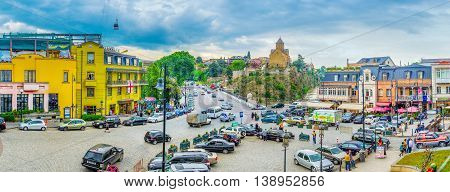 TBILISI GEORGIA - MAY 28 2016: The Square of Vakhtang Gorgasali with the large parking in the middle on May 28 in Tbilisi.