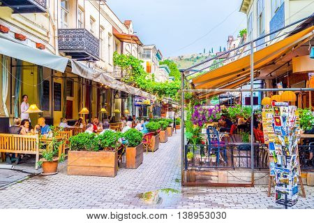 TBILISI GEORGIA - MAY 28 2016: The tourists neighborhood with fine cafes and restaurants of the local cuisine on May 28 in Tbilisi.