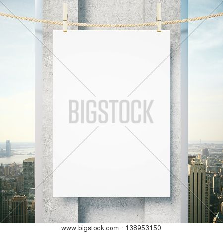 Blank poster hanging outside on rope with pegs.Concrete column and city view in the background. Mock up 3D Rendering