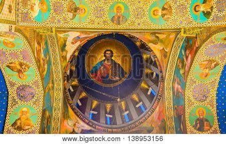 TBILISI GEORGIA - MAY 28 2016: The sentral cupola of Sioni Cathedral of Dormition with the fresco of Jesus Christ surrounded by the Saints in medallions on May 28 in Tbilisi.