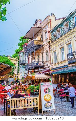 TBILISI GEORGIA - MAY 28 2016: Many of old town's streets occupied with family restaurants and cafes offering the tasty dishes and local wine on May 28 in Tbilisi.