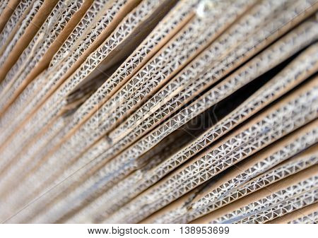 Brown corrugated cardboard useful as a blurred background