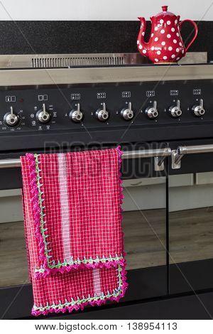 Homemade Crochet Dish Towel Hanging On A Stove