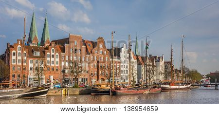 LUBECK, GERMANY - APRIL 20, 2014: Panorama of old ships at the quay in Lubeck, Germany