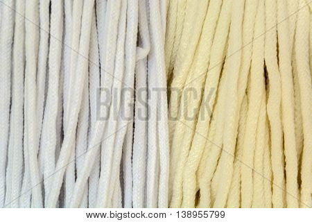 pattern and color in the form of tangled ropes beige. Spiral of rope.