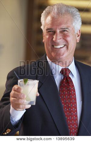 Man Having A Drink At A Bar
