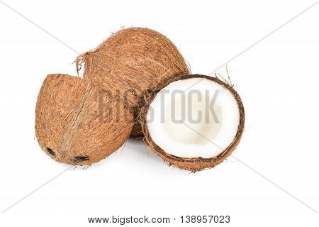 Whole coconut and the broken in half isolated on white background