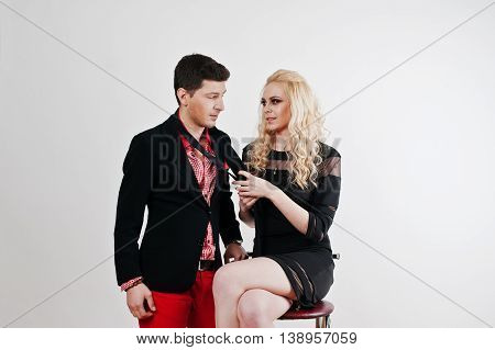 Studio Portrait Of Young Stylish Beautiful Couple Strangling Tie