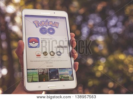 Idaho July 2016 - Android user ready to install Pokemon Go, a free-to-play augmented reality mobile game developed by Niantic for iOS and Android devices. Toned with a vintage retro instagram filter
