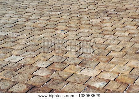 Wood blocks pavement texture. Abstract natural wooden background.