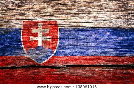 Slovakia flag painted on the old cracked wood with worn-out paint. Grunge look.