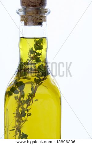 Bottle Of Olive Oil With Herbs