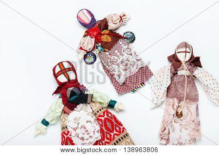 Handmade Ukraine traditional dolls background. Dolls on grey