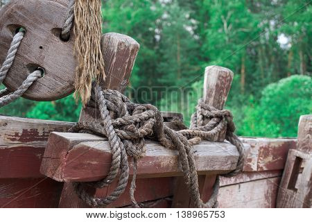 ropes and ropes on the upper deck of a wooden ship