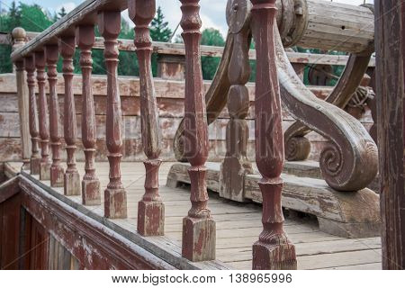 wooden elements of the railing on the mast of the ship