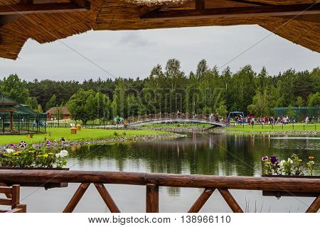 RUSSIA, BELGOROD - June 13 2016: New Belgorod zoo in the woods. Walkup and the bridge across the pond.