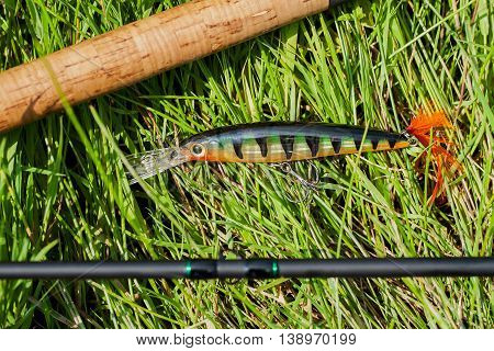 Close up spinning rod and tackle on natural background , concept of a rural getaway and fishing