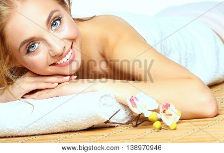 Closeup of an attractive young woman receiving massage .