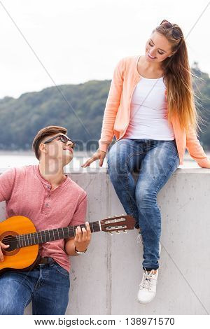 Man Expressing His Love By Music.
