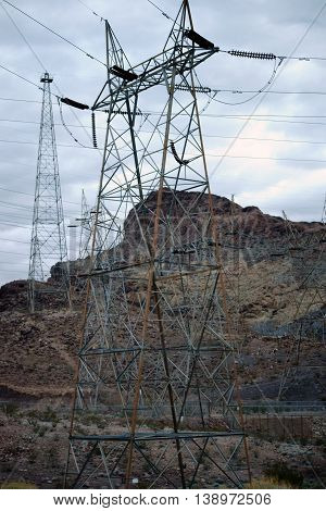 Power cable masts standing amid the red rocks of Black Canyon at Hoover Dam.