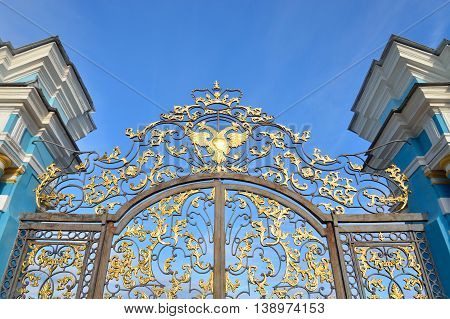 Fragment of Catherine palace fence in Tsarskoye Selo with golden double-headed eagle suburb of St.Petersburg Russia.