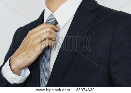 Businessman Suit Tie Holding Concept
