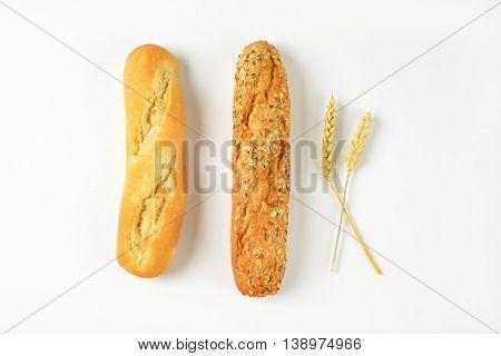 freshly baked bread rolls on white background