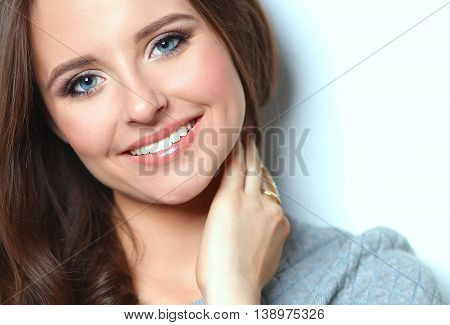 Portrait of an attractive fashionable young brunette woman.