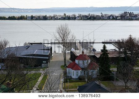 HARBOR SPRINGS, MICHIGAN / UNITED STATES - DECEMBER 25, 2015: A view of Ephraim Shay's Hexagon House, the Irish Boat Shop, Harbor Point mansions, and Little Traverse Bay, as seen from the top of the bluff above downtown Harbor Springs.