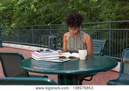African american college student studying on campus