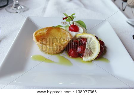 Appetizer of Delicious egg tart with cherry