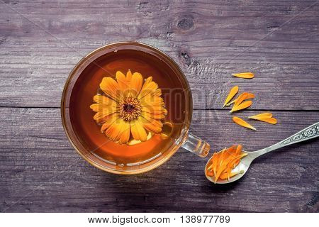 Healthy herbal tea with calendula flower and petals.