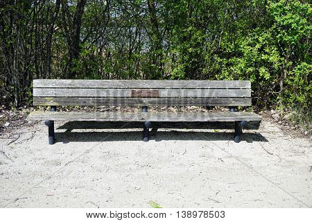 PLAINFIELD, ILLINOIS / UNITED STATES - MAY 4, 2015: Visitors to the Lake Renwick Heron Rookery Nature Preserve may sit and rest on a bench donated in memory of Lewis and Margaret Madison.
