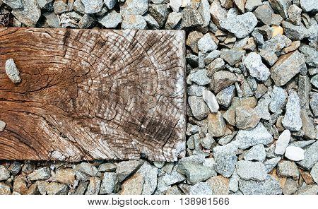 old wooden sleeper on railway railroad sleepers stones