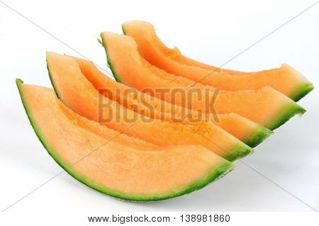 sliced fresh cantaloupe melon isolated on white background