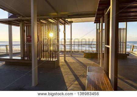 Gold Coast Surfers Paradise beach sun rays through slats under Elkhorn Avenue Esplande shelter