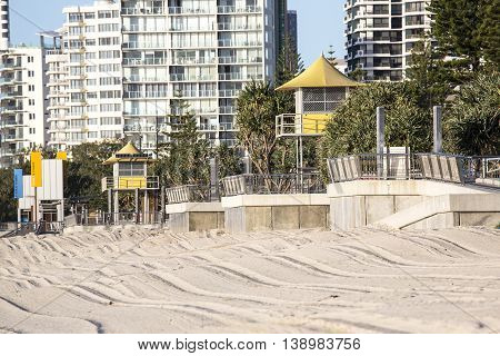 Gold Coast Surfers Paradise beach and surveillance towers at sunrise closeup