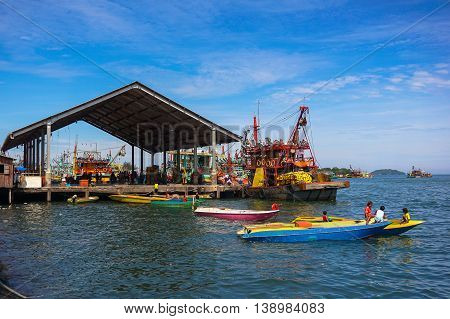 Kota Kinabalu,Sabah-June 24,2016:Fishing boats in SAFMA jetty fish market Kota Kinabalu Sabah Borneo on 24th June 2016.This jetty is the only fish landing point in & around Kota Kinabalu,Borneo.