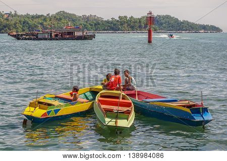 Kota Kinabalu,Sabah-June 24,2016:Young Filipinos boys on the boats at Kota Kinabalu.There are stateless,no identification for admission to Malaysian schools & thrown into the workforce at a young age.