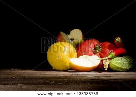 Fresh vegetables and fruits on the wooden table