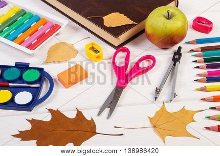 Book, School Accessories And Autumnal Leaves On White Boards, Back To School Concept