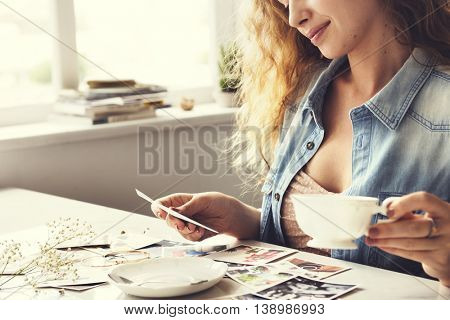 Female Reminiscing Photographs Tea Home Concept