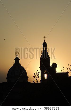 cupolas of churches backlighting in a golden sunset