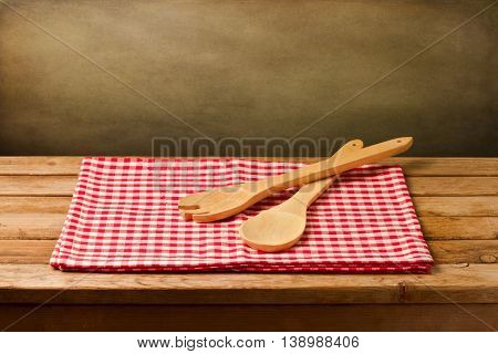Background with kitchen utensils on red ablecloth