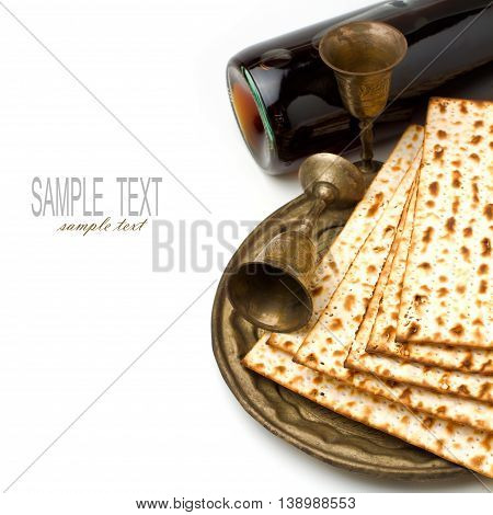 Matza and wine for passover seder celebration on white background