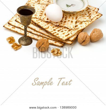 Matzo egg walnuts and wine for passover celebration on white background