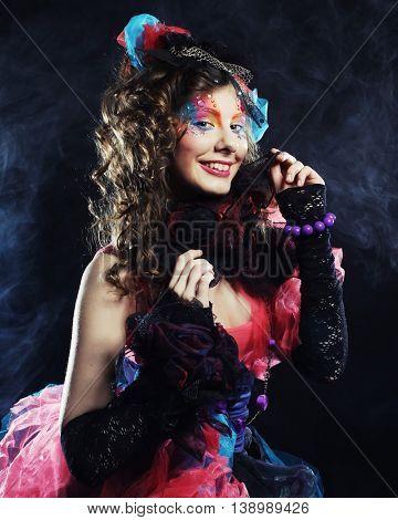 Fashion shot of woman in doll style. Creative make-up.Fantasy dress. Studio shot.