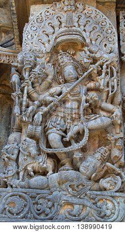 Lord Shiva killing a demon; carving in Hoysaleshwara temple at Halebidu Hassan district Karnataka state India Asia