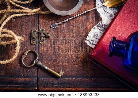 Vintage retro background with key and book over wooden box
