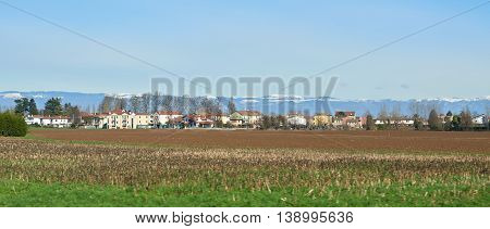 panoramic Landscape of countryside village with alps in Italy